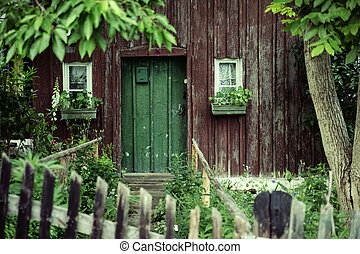 Old house with a deep green door