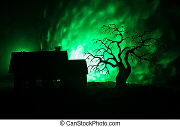 Old house with a Ghost at night with spooky tree or...