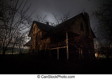 Old house with a Ghost in the forest at night or Abandoned...