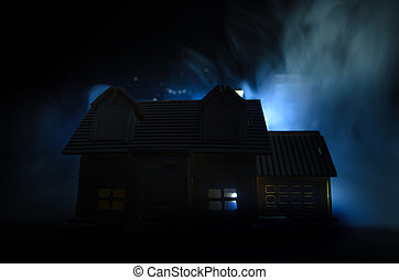 Old house with a Ghost in the moonlit night or Abandoned Haunted Horror House in fog. Old mystic villa with surreal big full moon. Horror concept.
