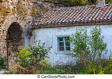old house with a tiled roof