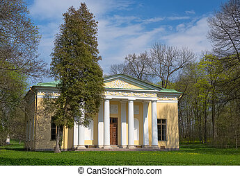 Old house with columns in the woods