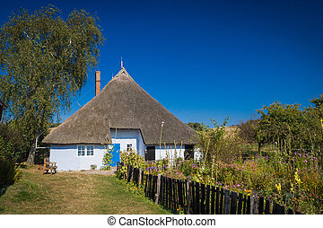 Old house with thatched roof on the island of Rügen