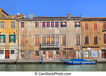 Old houses along canal in Venice, Italy.