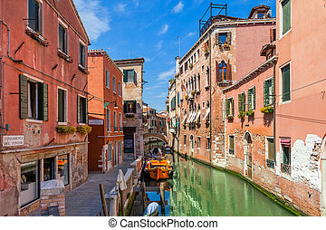 Old houses and small canal in Venice.
