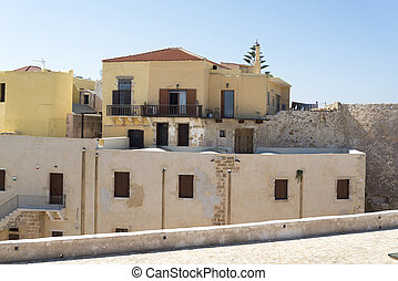 Old houses and stone fence on the island of Crete.