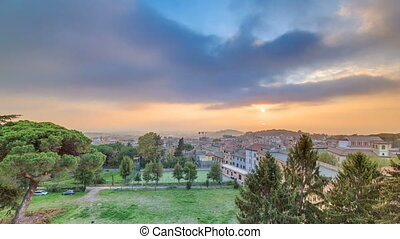 Old houses and trees during sunset in beautiful town of...