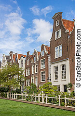 Old houses at the historical Begijnhof in Amsterdam