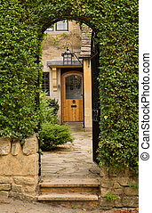 Old houses in Cotswold district of England - Entrance to...