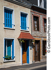 Old houses in Etretat on a sunny day in summer