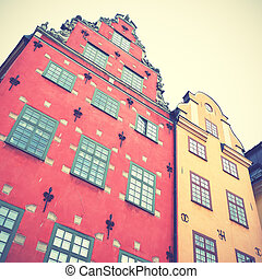 Old houses on Stortorget square in Stockholm. Retro style filtred image