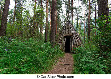 Old hovel of ancient altai people in the forest, Altai, ...