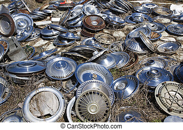 Old hubcaps on ground