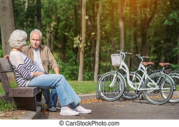Old husband and wife having rest in nature