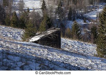 old hut in winter mountain scene