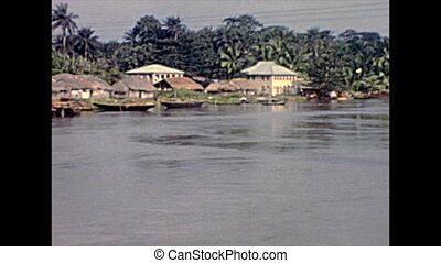 old huts on Lagos lagoon. Historical archival of Lagos city of Nigeria state of Africa in 1970s.