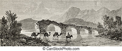 Old illustration of Camels fording a river near Turgutlu (once Cassaba) at the foot of Mount Sypilus. Created by Gaiaud, published on Le Tour du Monde, Paris, 1864