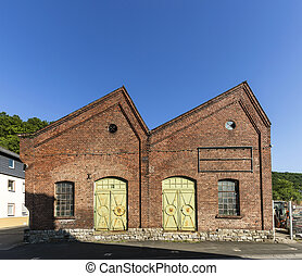 old industrial brick building in a small village in Hesse