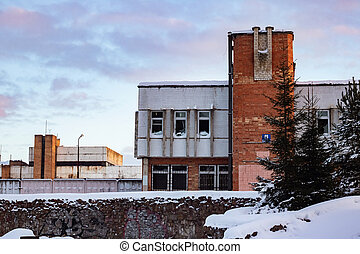 Old industrial building at sunset in winter