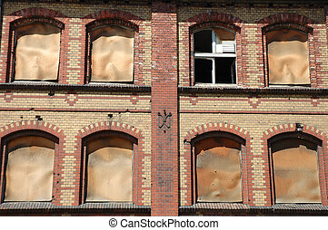 Old industrial building wall with windows background