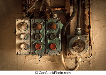 Old industrial switches on wall