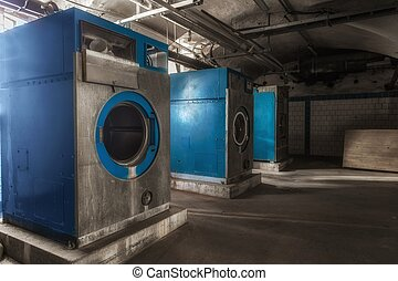 Old industrial washing machine in the basement