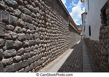 Old Inka wall in city of Cuzco in Peru, South America.