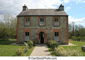Old Irish farm house - exterior of old Irish farmhouse in...