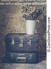 Old iron chest on the background wall