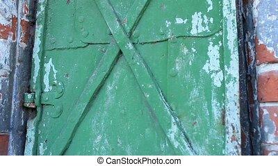 old iron door opens. Tripod.
