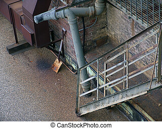 Old iron fire escape with shovel