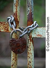 Old iron gates closed wiyh chain and  padlock