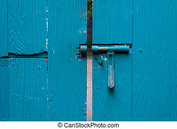 old iron lock with blue door