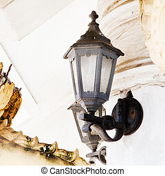 Old iron street lantern on a wall