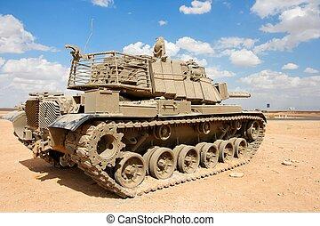 Old Israeli Magach tank near the military base in the desert...