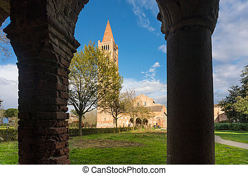 Pomposa, Italy-march 31,2018:people admire the old Italian abbey of Pomposa during a sunny day