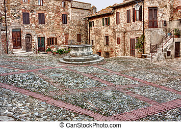 old italian square - old square with water well in the ...