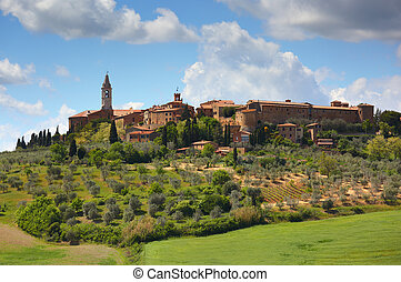 Old italian town on top of hill in Tuscany
