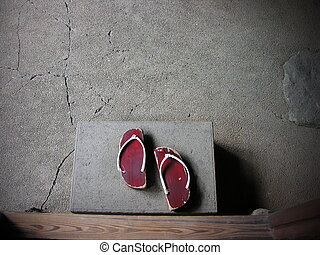 Old japanese clogs, at the entrance of an apartament