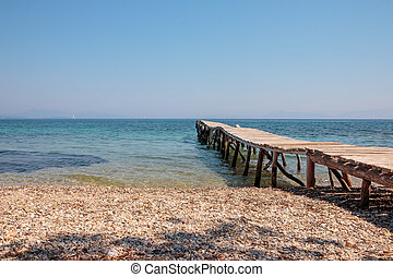 old jetty walkway pier and the sea. Stones beach. adventure Travel concept. wild beach. Copy space