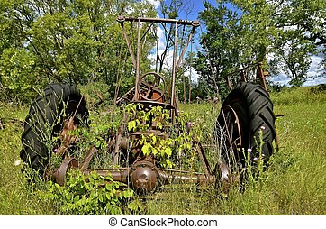 Old junked tractor with front end loader