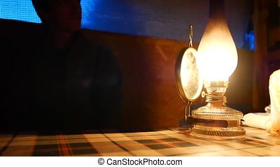 Old kerosene lamp on the table.