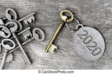 old key and 2020 written on ring - 2020 written on a ring ...