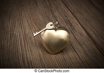 Old key and gold heart. Key of my heart concept. Valentine's day greetings.