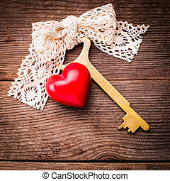 Old key and heart