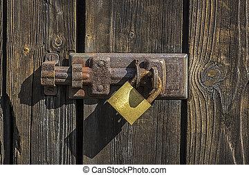 Old key lock on wooden door