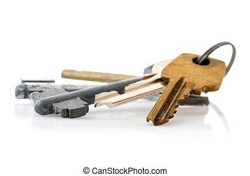 Old keys isolated on white background