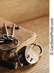 old keys on a old book, antique wood background