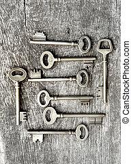 old keys on a plank