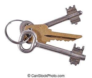 Old keys on a white